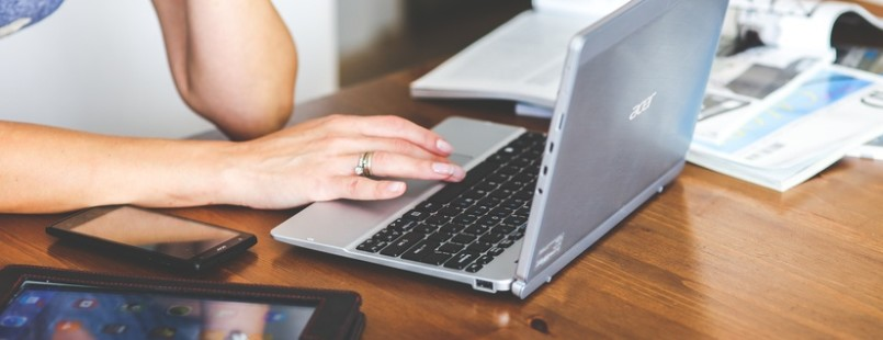 woman-hand-smartphone-laptop-large